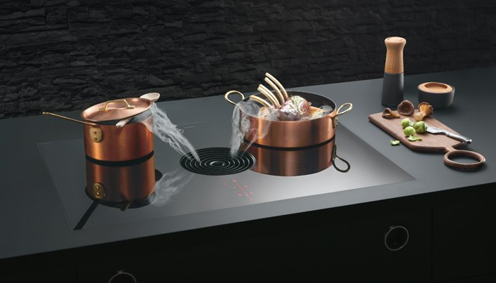 Voordelen van een kookplaat met geïntegreerd afzuigsysteem | Satink Keukens